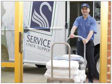 service-linen-driver-and-truck